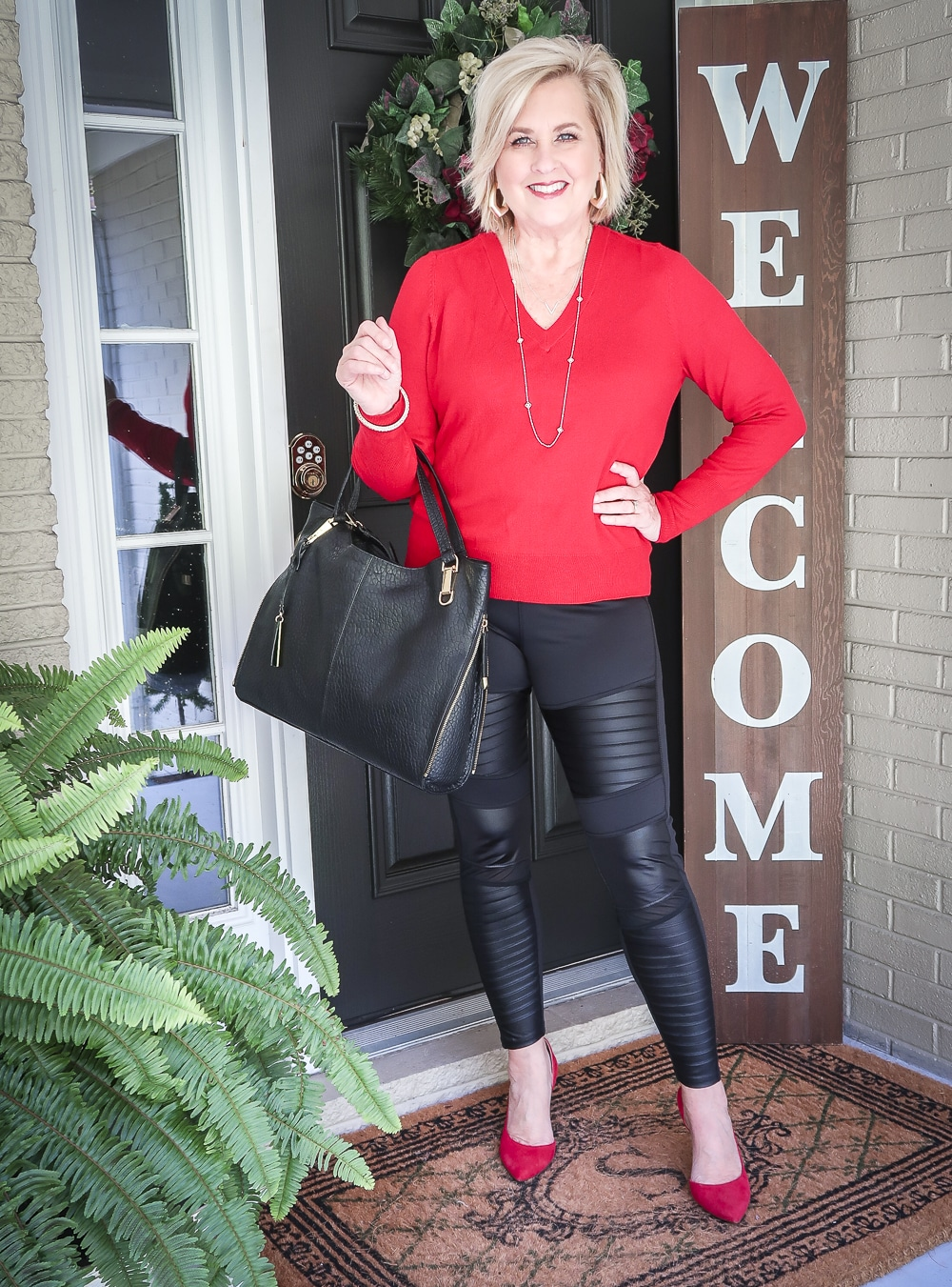 Fashion Blogger 50 Is Not Old is looking modern and edgy in this pair of black faux leather moto leggings, red sweater, and red pumps