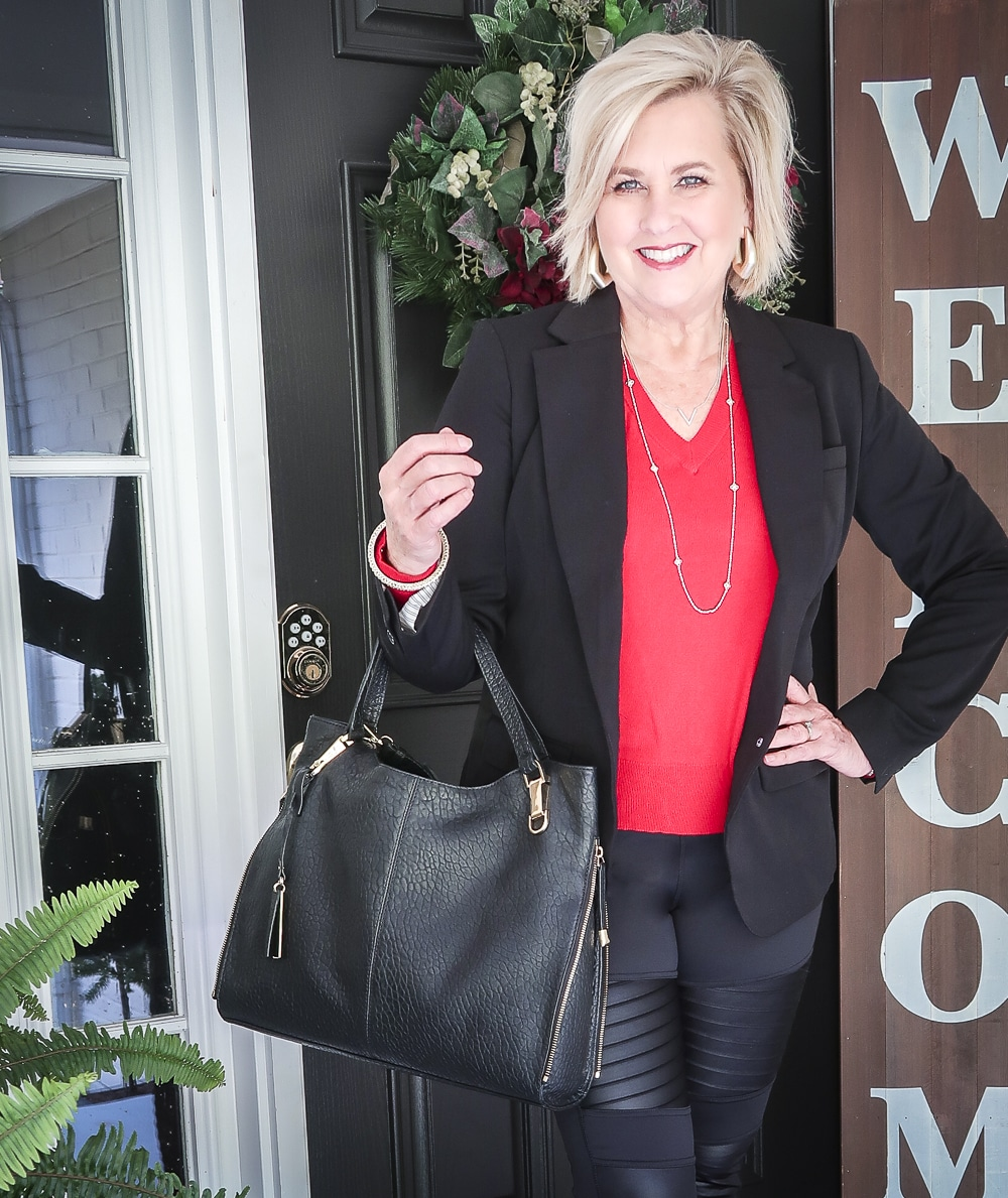 Fashion Blogger 50 Is Not Old is looking modern and edgy in this a red sweater and black blazer