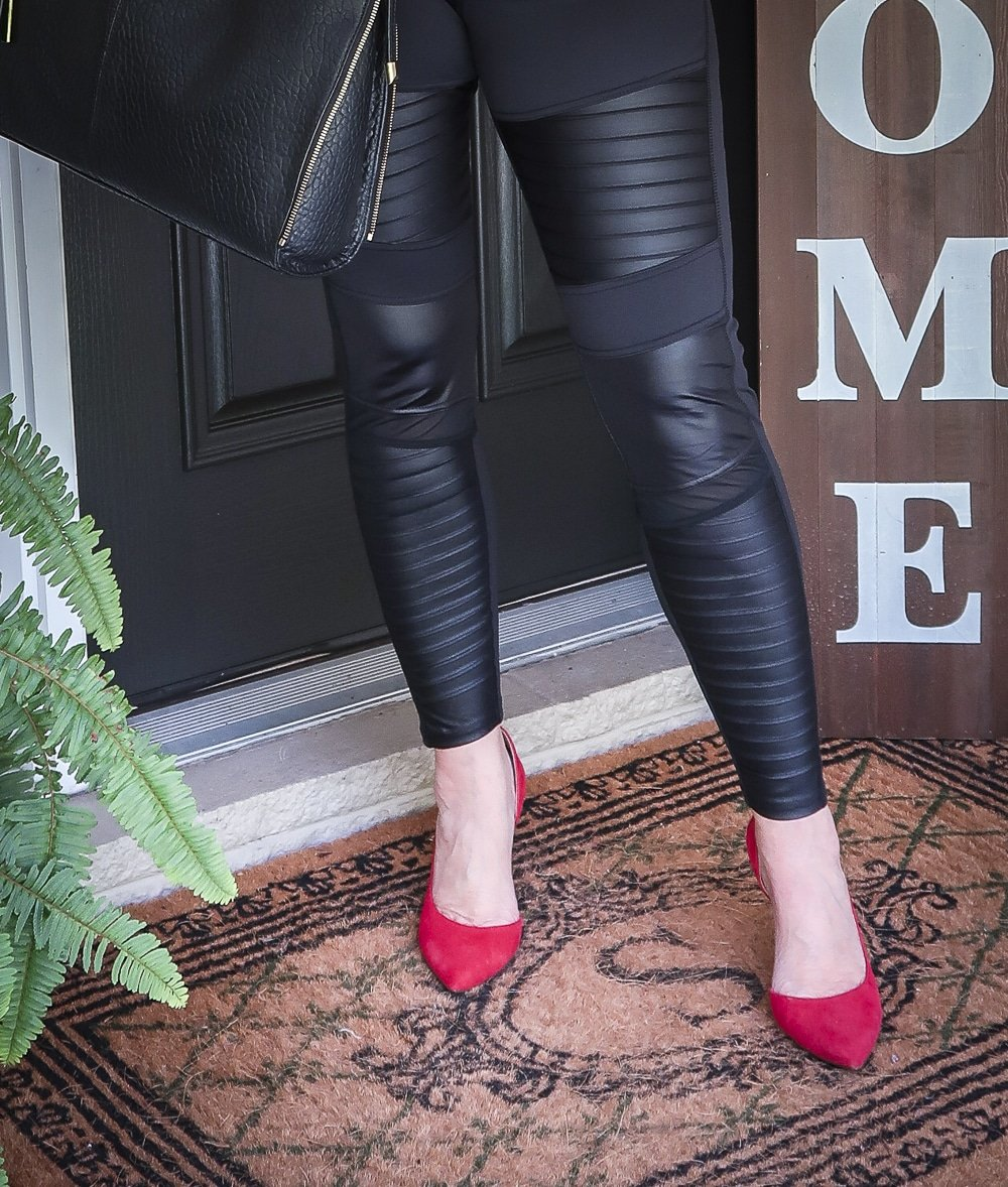 Fashion Blogger 50 Is Not Old is looking modern and edgy in this pair of black faux leather moto leggings and red pumps