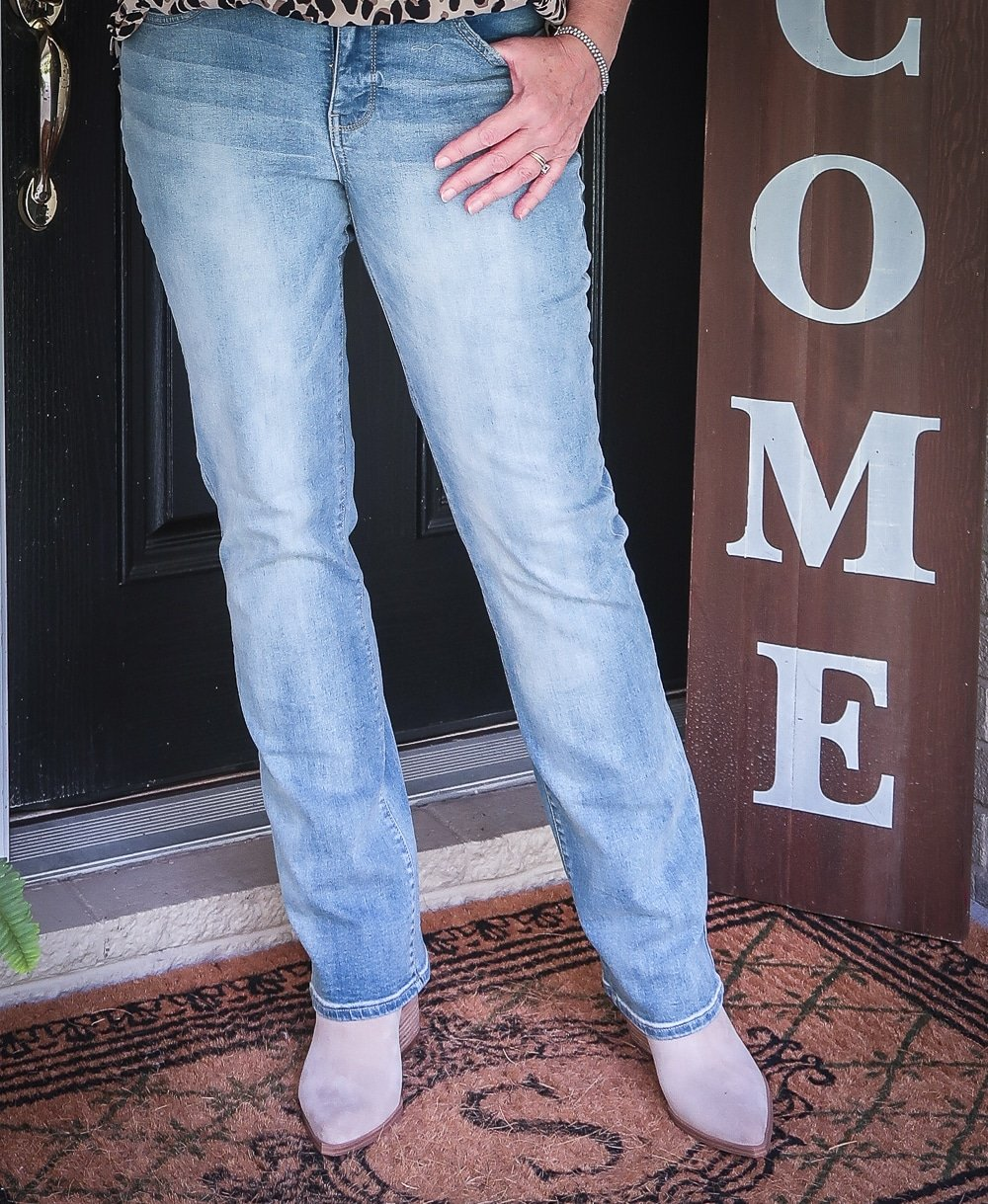Fashion Blogger 50 Is Not Old is wearing a pair of straight leg jeans