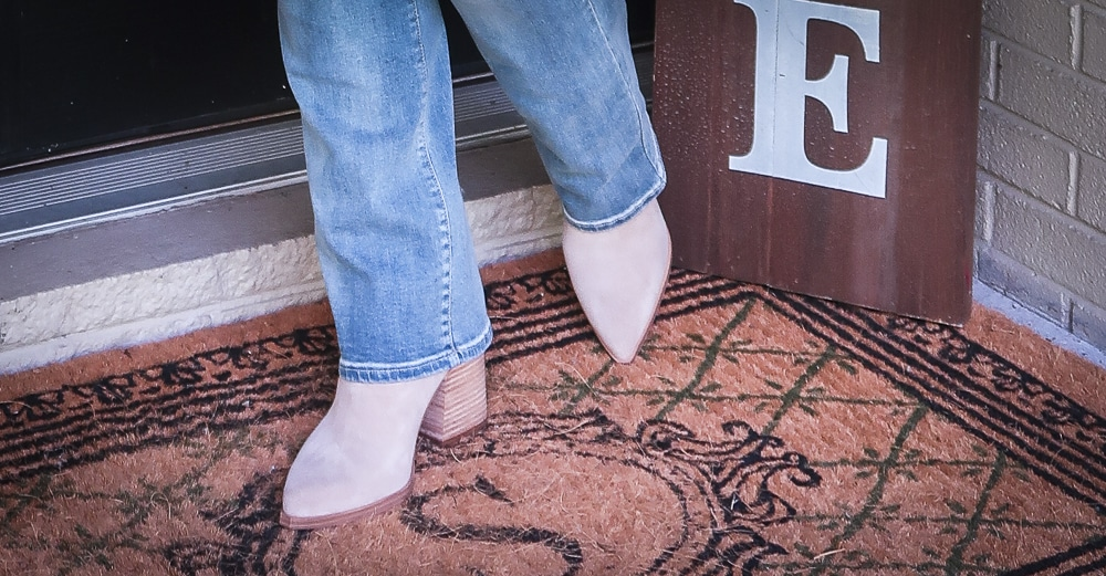 Fashion Blogger 50 Is Not Old is wearing a pair of taupe suede ankle booties