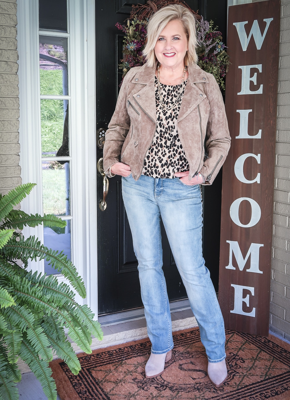 Fashion Blogger 50 Is Not Old in a suede moto Jacket and straight leg jeans