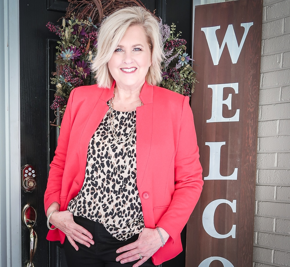 Fashion Blogger 50 Is Not Old is wearing a leopard print statement top and a red blazer