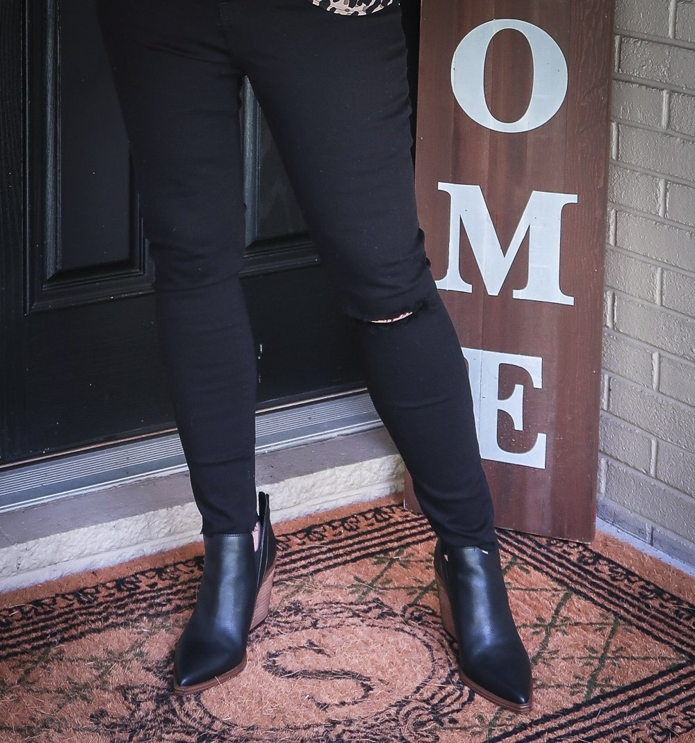 Fashion Blogger 50 Is Not Old is wearing a pair of black distressed jeans by Madewell