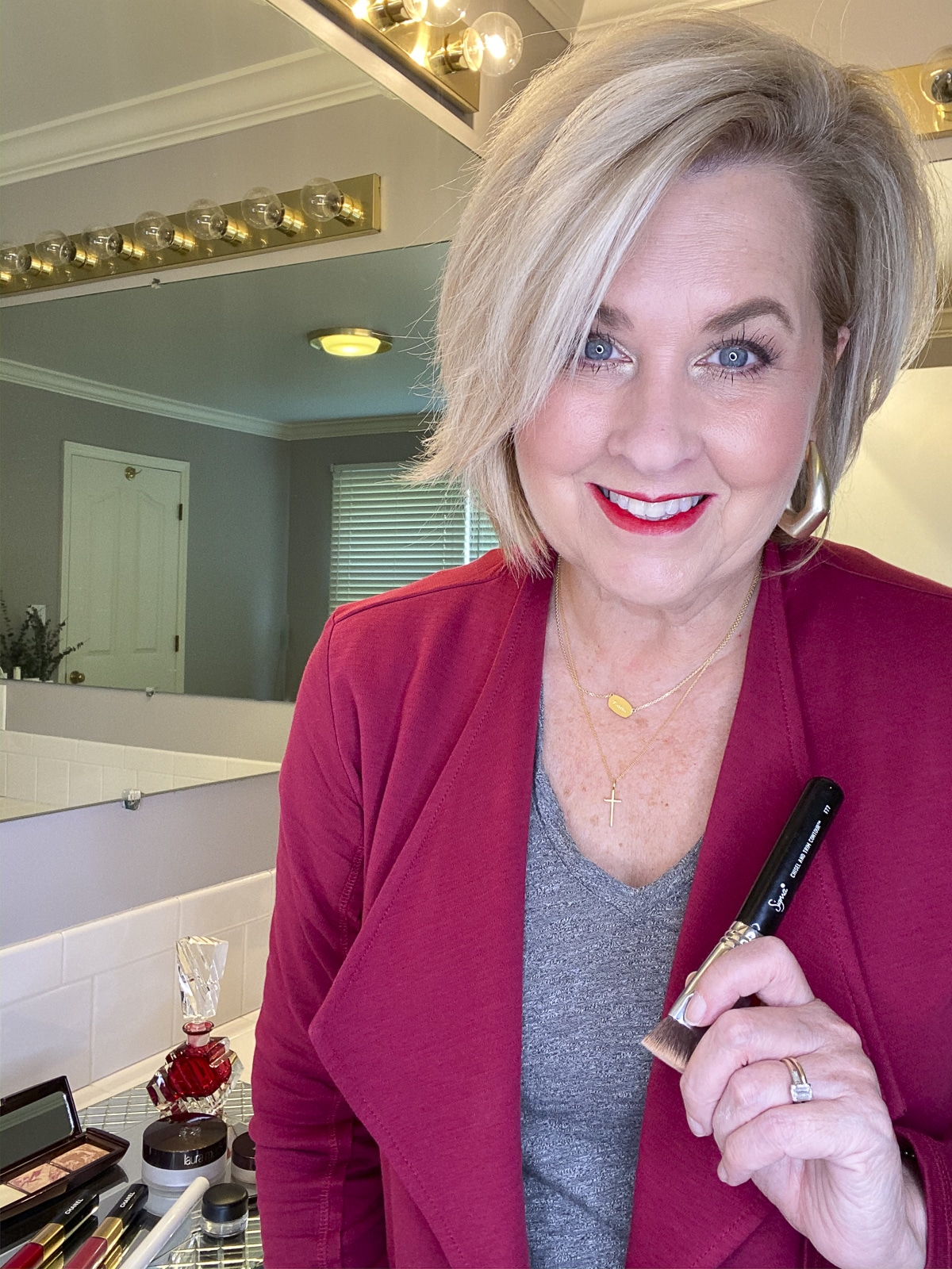 Fashion Blogger 50 Is Not Old showing her freshly applied makeup from her one stop shop for all things beauty - Nordstrom