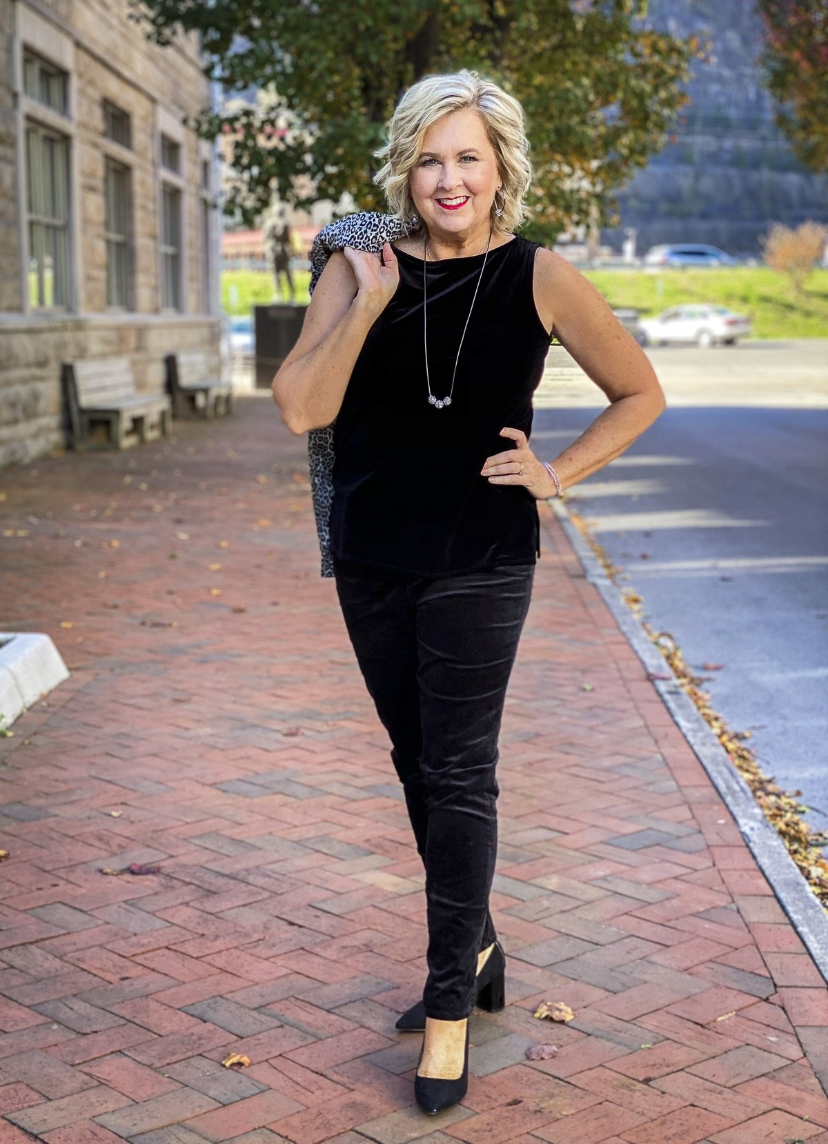 Fashion Blogger 50 Is Not Old is Holiday festive in a black velvet tank top and jeggings from Chico's