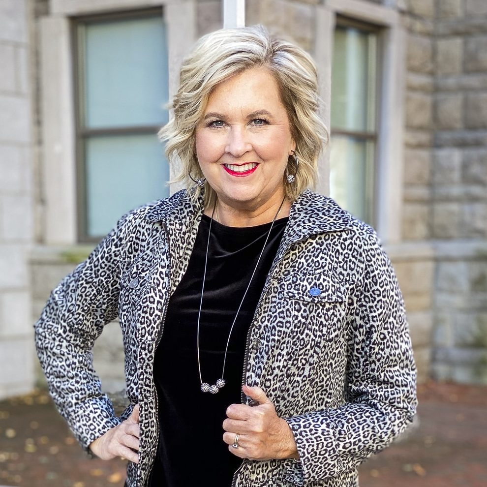 Fashion Blogger 50 Is Not Old is wearing a black velvet tank top and an animal print jacket from Chico's