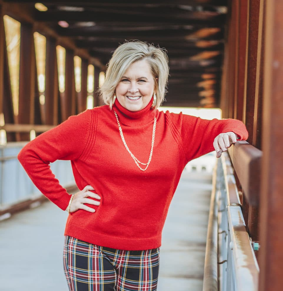 Fashion Blogger 50 Is Not Old is looking festive in this red turtleneck sweater and gold jewelry from Kendra Scott