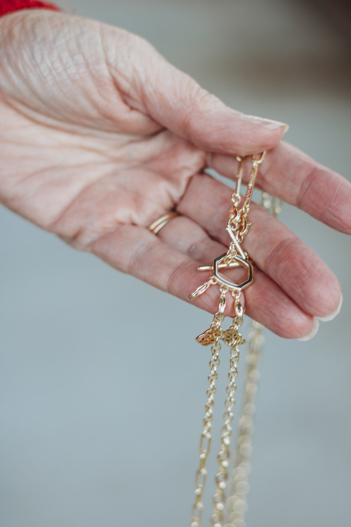 Fashion Blogger 50 Is Not Old is showing a piece of jewelry from Kendra Scott