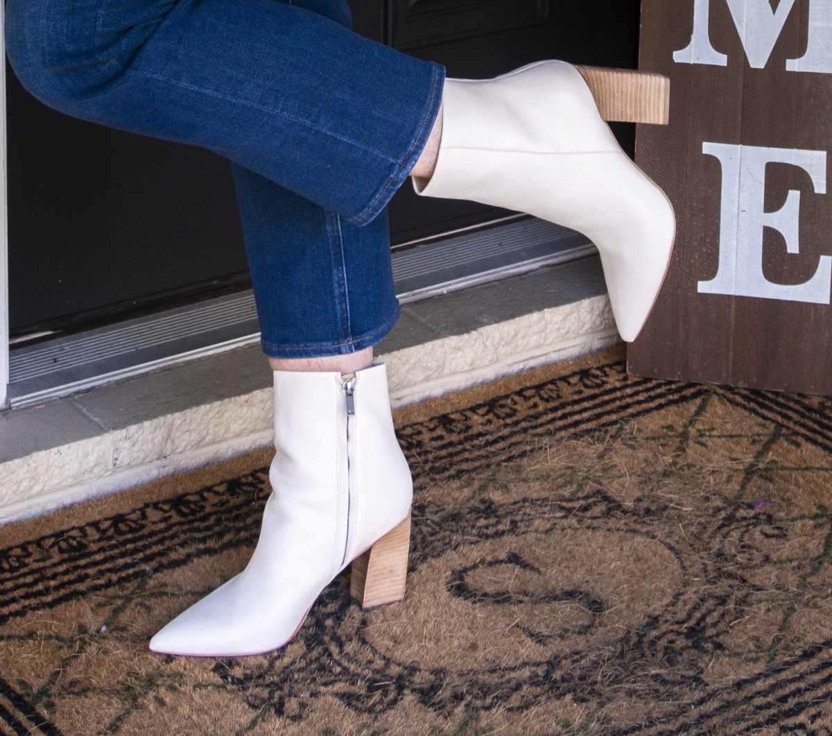 Fashion Blogger 50 Is Not Old is wearing white pointy toe ankle boots