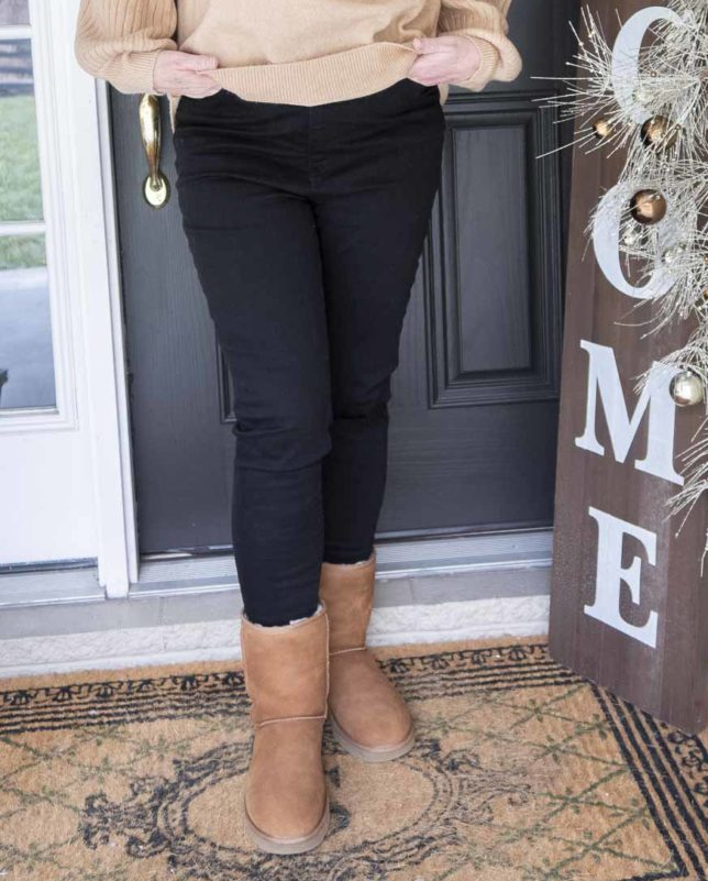 Fashion Blogger 50 Is Not Old wearing black distressed jeans with UGG boots