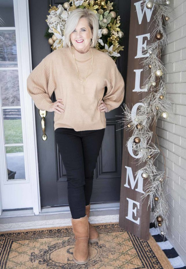 Fashion Blogger 50 Is Not Old wearing a brown and black outfit with UGG boots