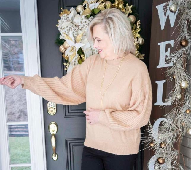 Fashion Blogger 50 Is Not Old wearing a brown sweater with ribbed oversized sleeves