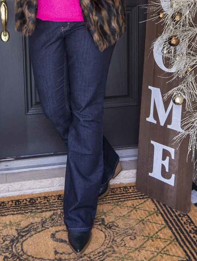 Over 40 Fashion Blogger 50 Is Not Old is wearing flare jeans, and black pointy toe boots