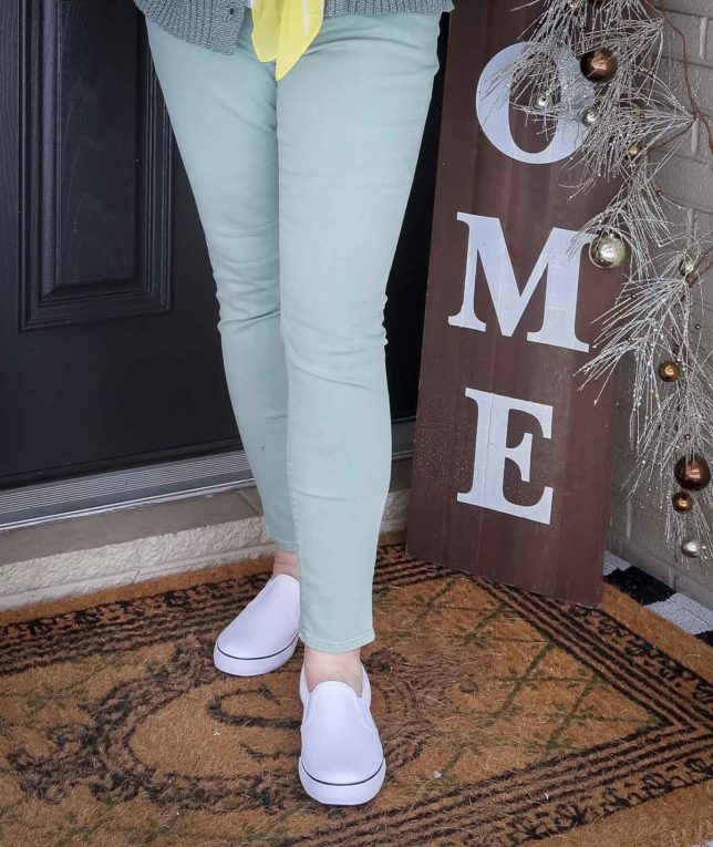 Fashion Blogger 50 Is Not Old is wearing mint green jeans with white pull-on sneakers