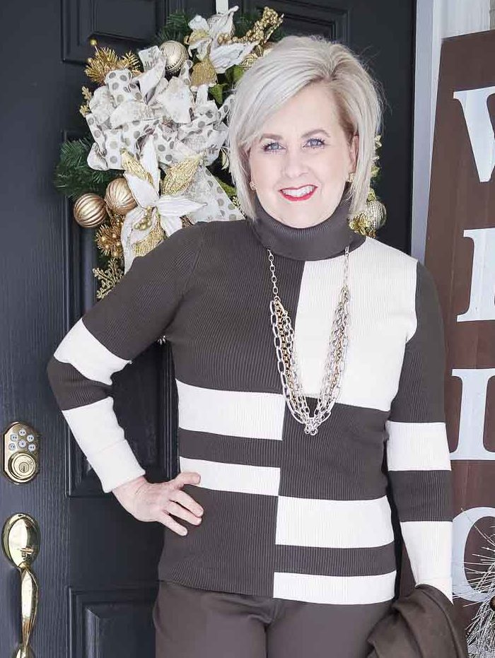Fashion Blogger 50 Is Not Old is wearing a colorblocked turtleneck