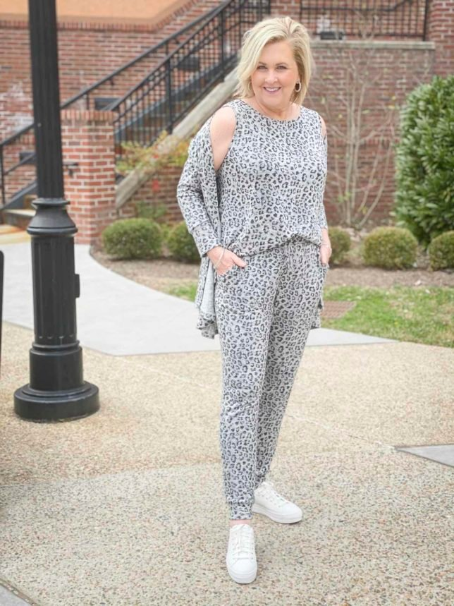 Fashion Blogger 50 Is Not Old is wearing an animal print tank, jogger, and cardigan luxe loungewear set from Chico's and Ked's platform sneakers