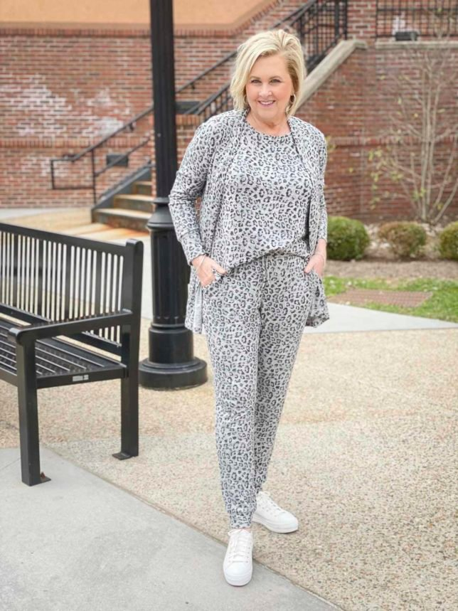 Fashion Blogger 50 Is Not Old is wearing animal print luxe loungewear from Chico's and Ked's platform sneakers