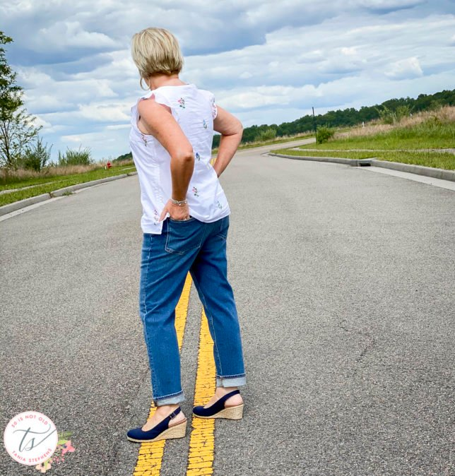 Fashion Blogger 50 Is Not Old is showing the back of a white top and boyfriend jeans