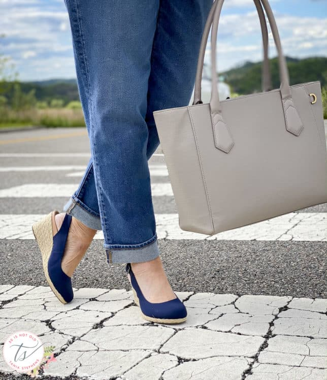 Fashion Blogger 50 Is Not Old is wearing boyfriend jeans, navy espadrilles, and carrying a Dagne Dover tote
