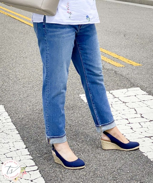 Fashion Blogger 50 Is Not Old is wearing boyfriend jeans and navy espadrilles