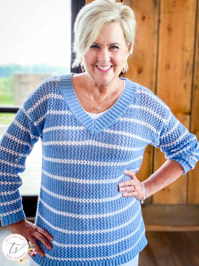 Fashion Blogger 50 Is Not Old is wearing a blue and white striped mesh sweater from Talbots