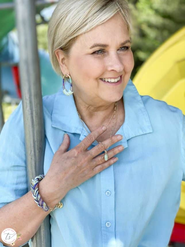 Fashion Blogger 50 Is Not Old is wearing a blue topaz front tie shirt with paracord jewelry from Kendra Scott