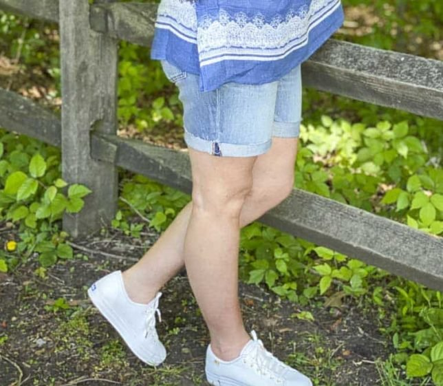 Fashion Blogger 50 Is Not Old is wearing denim shorts and white Keds platform sneakers