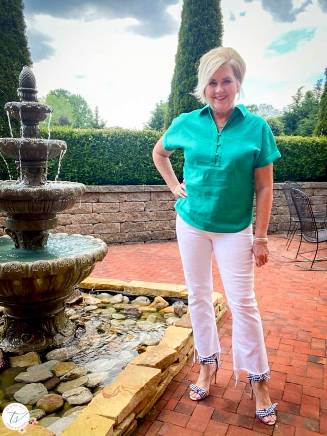 Fashion Blogger 50 Is Not Old is wearing a jade linen pullover shirt with white crop jeans and navy and white gingham heels