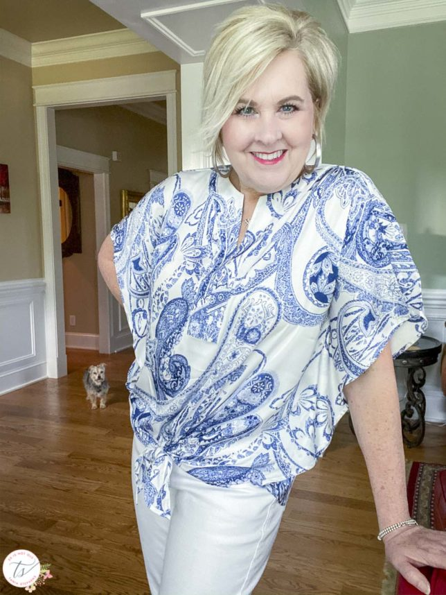 Fashion Blogger 50 Is Not Old is wearing a navy and white paisley tie-front top