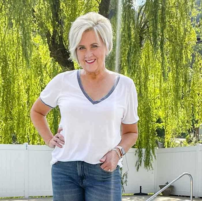 Fashion Blogger 50 Is Not Old is wearing a casual style of t-shirt and jean shorts