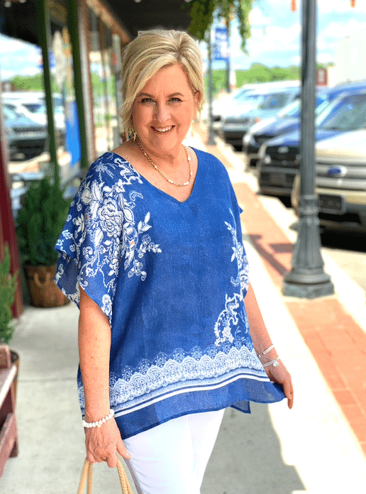Fashion Blogger 50 Is Not Old is wearing a comfortable poncho