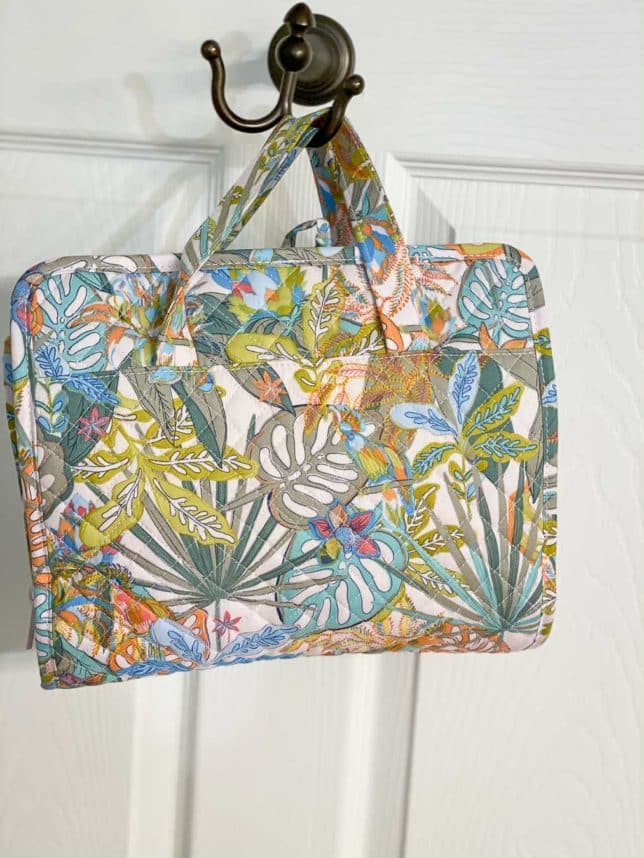 Fashion Blogger 50 Is Not Old is showing her hanging travel organizer Vera Bradley