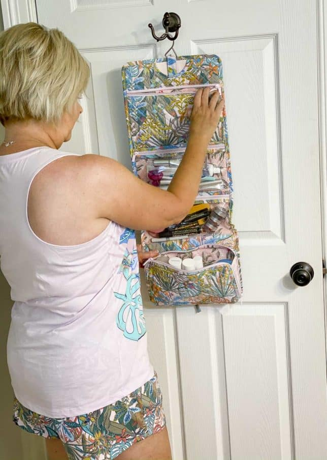 Fashion Blogger 50 Is Not Old is unpacking her hanging travel organizer Vera Bradley