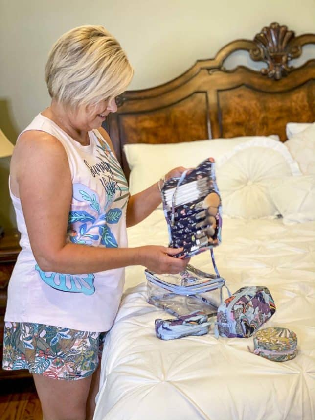 Fashion Blogger 50 Is Not Old is swearing pajamas from Vera Bradley and unpacking her makeup brushes