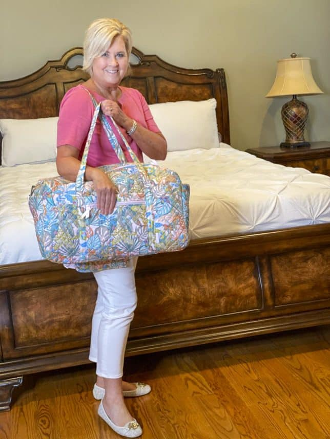 Fashion Blogger 50 Is Not Old is showing her traveling duffle bag from Vera Bradley
