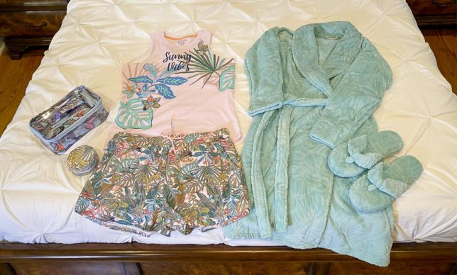 Fashion Blogger 50 Is Not Old is showing her pajamas, robe, and slippers from Vera Bradley