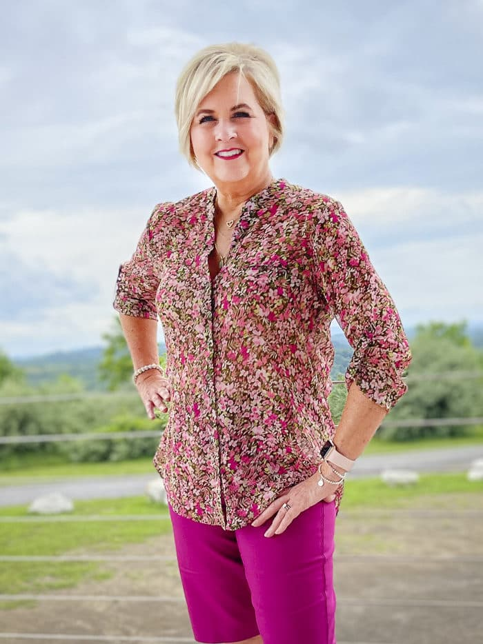 Fashion Blogger 50 Is Not Old is wearing a floral button-up blouse