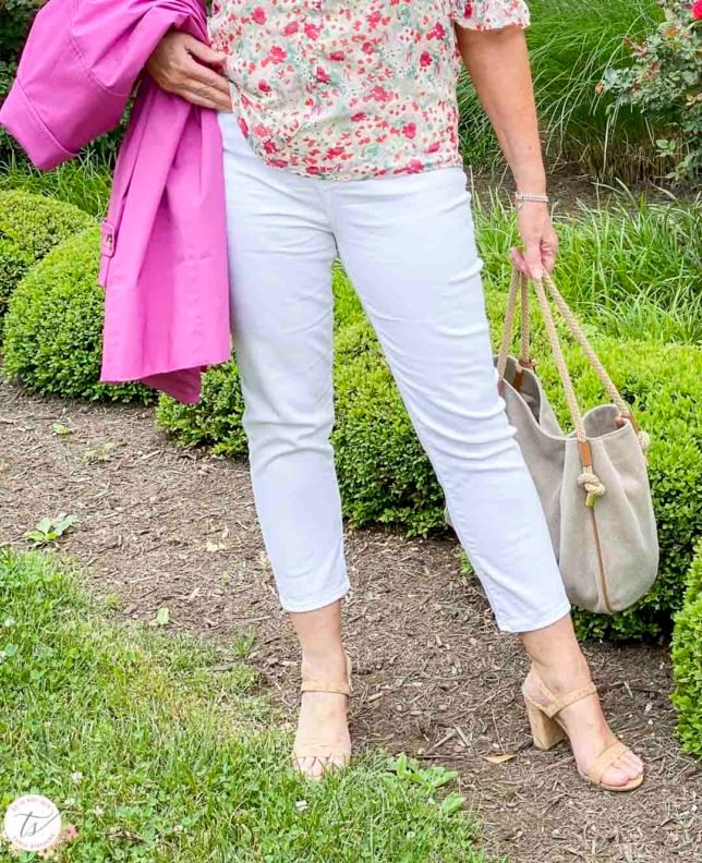 Fashion Blogger 50 Is Not Old is wearing white crop pants, cork heels, and a Michael Kors handbag