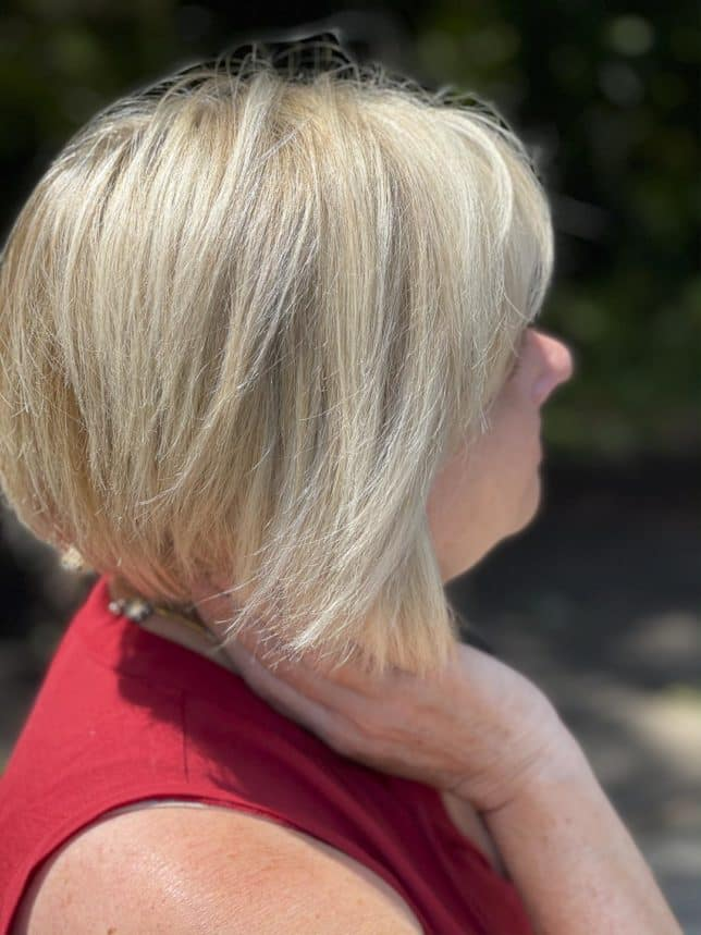 Fashion Blogger 50 Is Not Old's hair is bright and shinny after using Hair Biology products