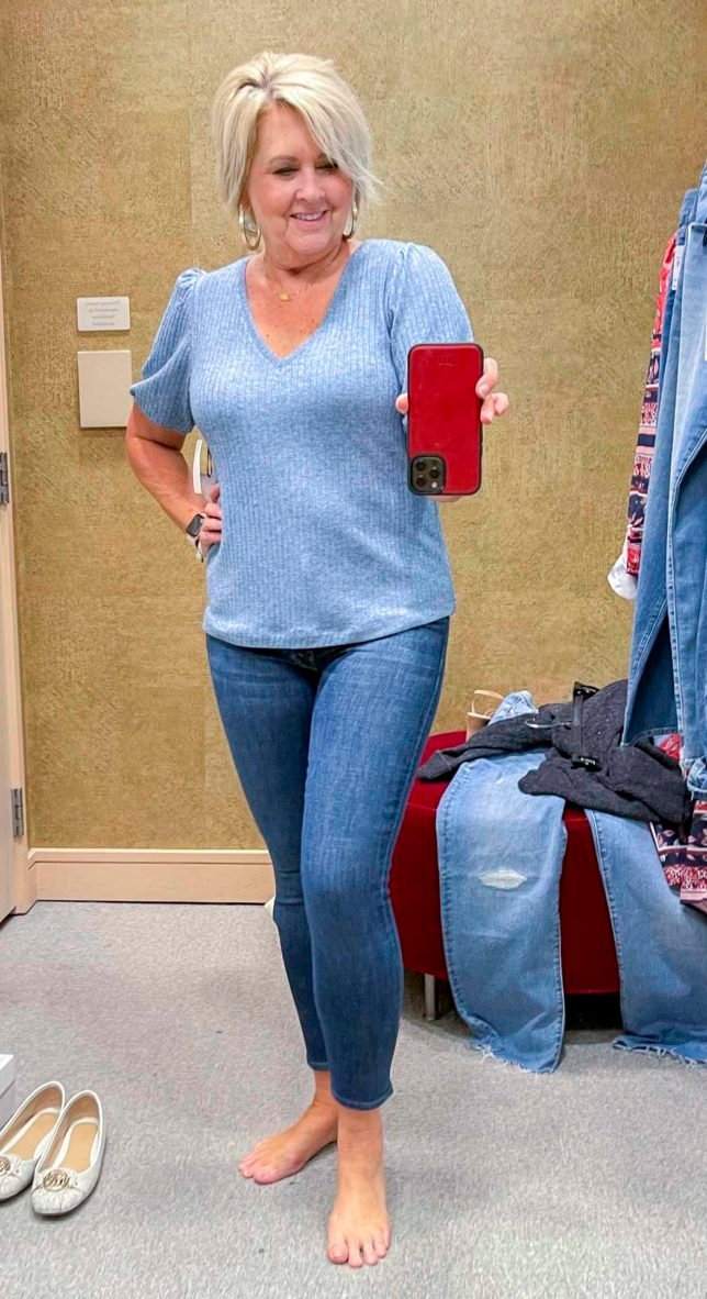 Fashion Blogger 50 Is Not Old is wearing a blue v-neck sweater with skinny jeans from the Nordstrom Anniversary Sale