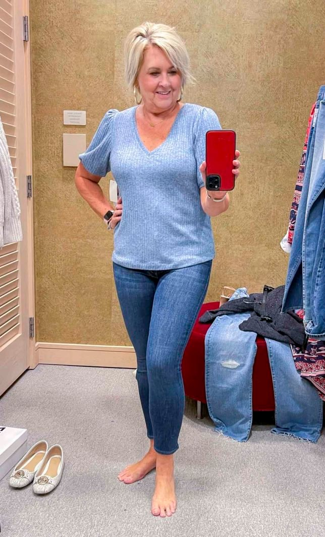 Fashion Blogger 50 Is Not Old is wearing a blue sweater with skinny jeans from the Nordstrom Anniversary Sale