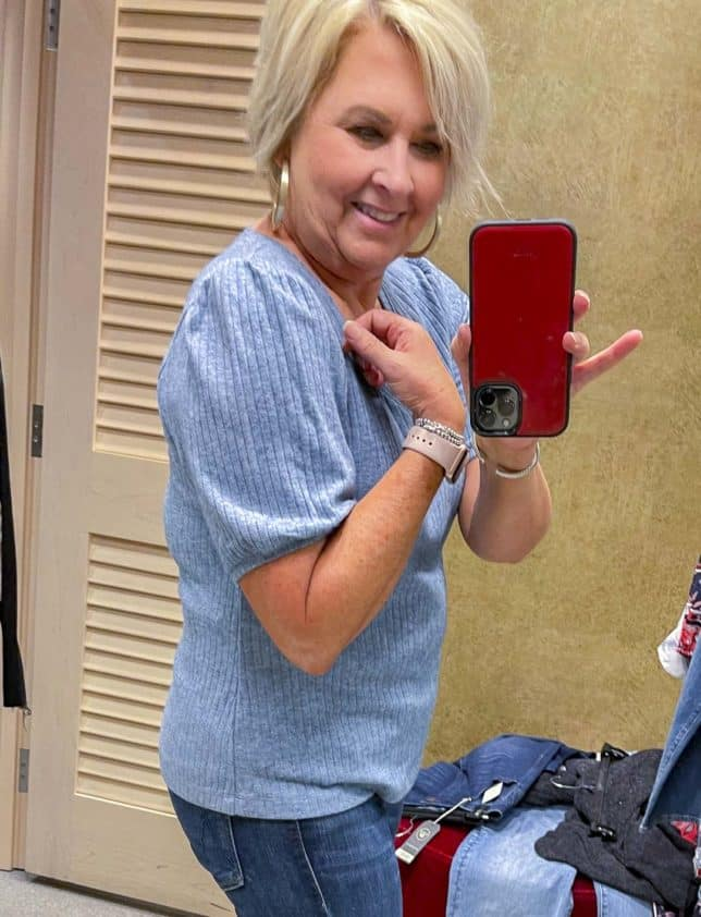 Fashion Blogger 50 Is Not Old is wearing a blue puff sleeve sweater from the Nordstrom Anniversary Sale