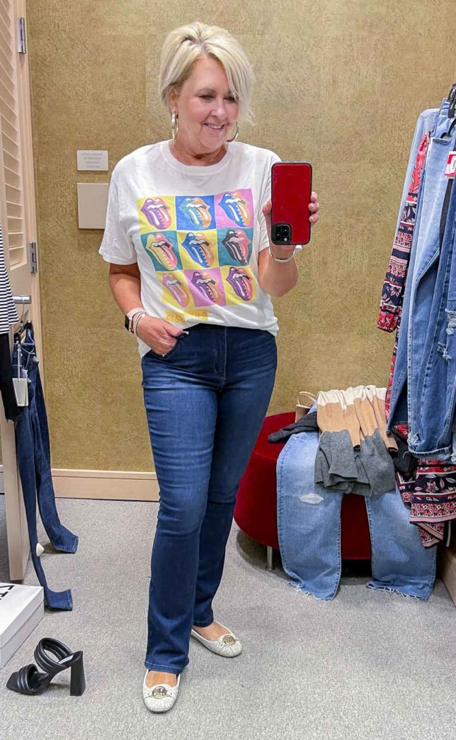 Fashion Blogger 50 Is Not Old is wearing a rolling stones t-shirt with bootcut jeans from the Nordstrom Anniversary Sale