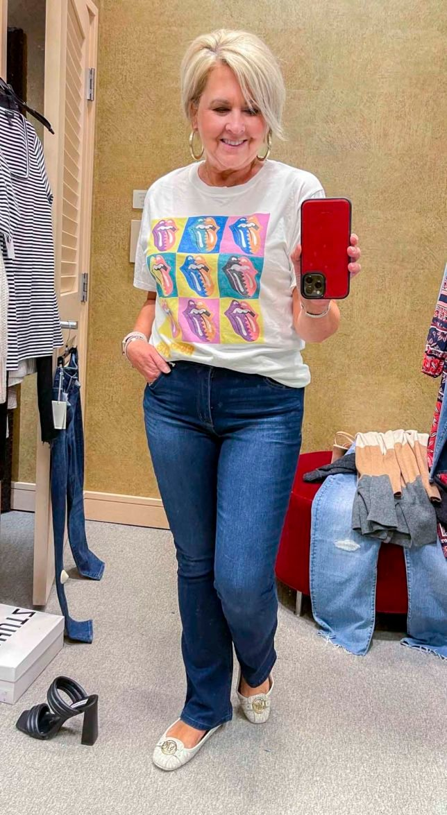 Fashion Blogger 50 Is Not Old is wearing a colorful rolling stones t-shirt with bootcut jeans from the Nordstrom Anniversary Sale