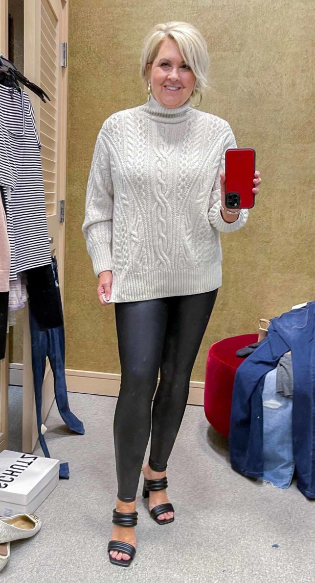 Fashion Blogger 50 Is Not Old is wearing a cable knit cashmere and wool sweater with Spanx leggings from the Nordstrom Anniversary Sale