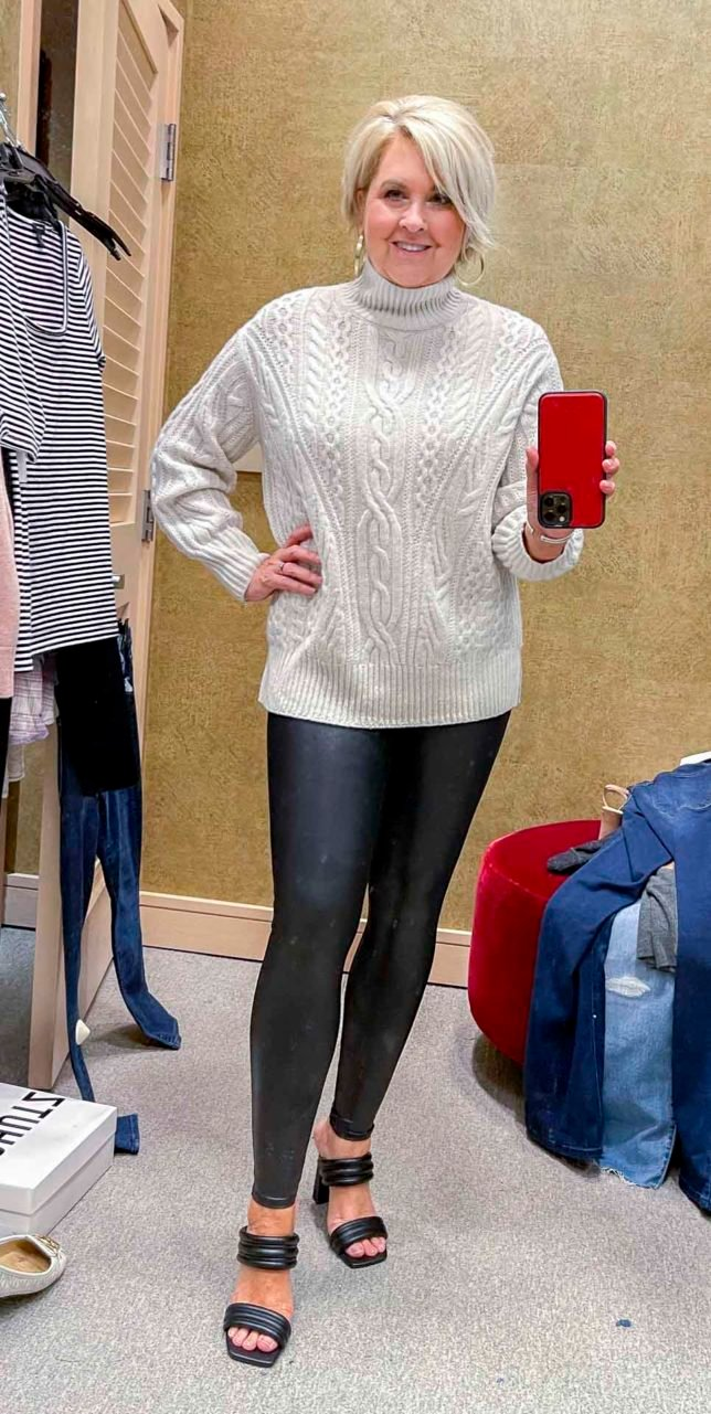 Fashion Blogger 50 Is Not Old is wearing a cable knit cashmere and wool sweater with Spanx faux leather leggings from the Nordstrom Anniversary Sale