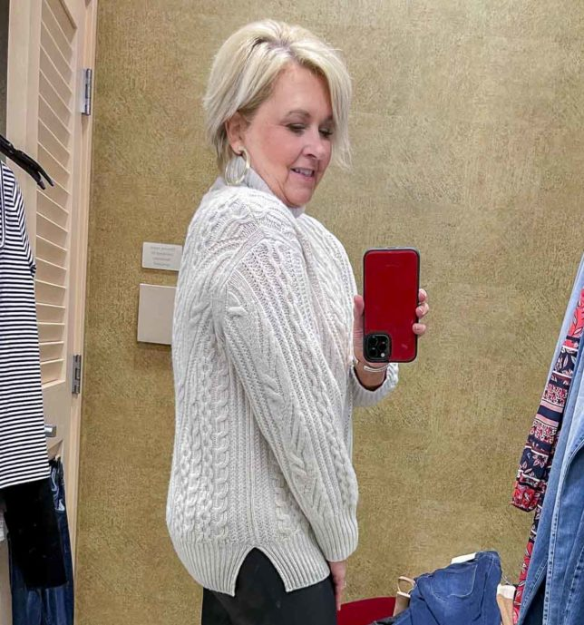Fashion Blogger 50 Is Not Old is wearing a cable knit cashmere and wool sweater from the Nordstrom Anniversary Sale