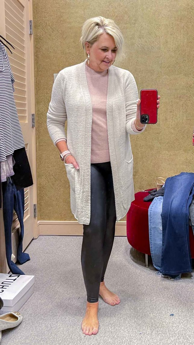 Fashion Blogger 50 Is Not Old is wearing a ivory cardigan, a pink cashmere and wool sweater, and Spanx faux leather leggings from the Nordstrom Anniversary Sale