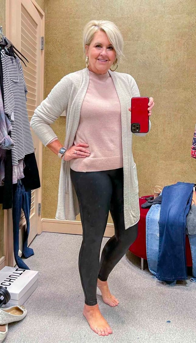 Fashion Blogger 50 Is Not Old is wearing a pink cashmere and wool sweater with Spanx faux leather leggings from the Nordstrom Anniversary Sale
